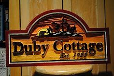 A custom carved sign for your cottage as a Christmas gift is a beautiful way of letting somone know you love them. Find out how more about cottage signs at The Sign Depot…