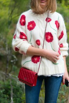 Such a cute flowery wool sweater, the red Chanel bag looks adorable with it