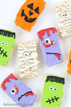 Halloween Rice Krispie Treats - Easy Halloween party food! Store-bought cereal treats and frosting. Frankenstein, mummy, zombie, and pumpkin.
