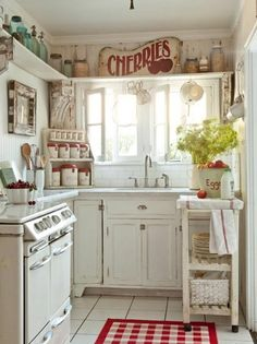 "Adorable Country Kitchen... Could do a shelf all the way around level w top of cabinets! So cute! I also like very much the sign ""cherries"""