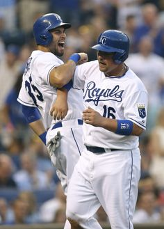 Billy Butler and Eric Hosmer celebrate after scoring on a Mike Moustakas single in the second inning during a game against the Minnesota Twins at Kauffman Stadium August, 5, 2013