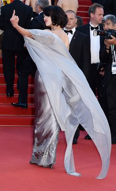 well alrighty then asia argento in ermanno scervino at cannes on the red carpet.... flipping the bird!
