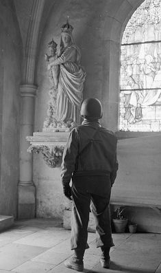 Soldier looking at the Blessed Mother