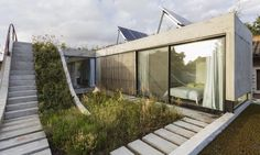 Luxurious solar home wraps around a sloped green roof | Inhabitat - Green Design, Innovation, Architecture, Green Building
