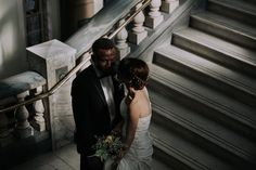 A moody shot of the bride and groom inside Islington town hall on the marble stair case. Queue window light and BAM - perfect.