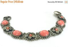 Hey, I found this really awesome Etsy listing at https://www.etsy.com/listing/461588384/art-nouveau-bracelet-mottled-coral-oval