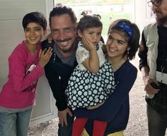 "Just a month before his death, Chris Cornell visited with Afghan and Syrian children at the Eleonas Camp for refugees in Athens, Greece. ""Chris' promise was to help the most vulnerable children,"" Vicky Cornell said.  (International Rescue Committee)"