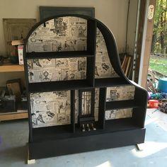 Baby grand piano repurposed into a book shelf