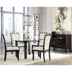 With a sleek straight-line contemporary design bathed in a dark espresso color finish complementing the Okoume and Ash veneers, the Trishelle Dining Room Collection by Ashley Furniture adds an exceptional Metro Modern flair to any home environment. With the upholstered chairs in a variety of colors to choose from, the Trishelle Collection is sure to put a spark in the atmosphere of any dining room decor.