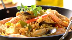 SEAFOOD AND CHICKEN PAELLA - A combination of prawns, mussels, fish and chicken flavoured with peppers, garlic and tomatoes makes this a meal to remember. Chicken Paella, Seafood Paella, Fish And Chicken, Paella Recipe, Chicken Flavors, Mussels, Biryani, Light Recipes, Seafood Recipes