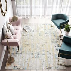 Talk about a wow factor! We are loving the gold and blue hues of this contemporary rug. It's the last day of our Labor Day sale, don't miss out on lovely pieces like this one! #labordaysale #contemporary #plushrugs #vintageinspo #soft-touch #abstract #neutralivory #cosmoliving #gold #blue