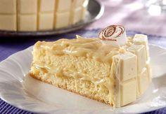 Massa:  - ½ tablete de manteiga sem sal (100 g)  - 200 g de açúcar refinado (1 ¼ xícara de chá)  - 2 ovos tipo extra (claras e gemas separadas)  - ½ colher (chá) de essência de baunilha (3 g)  - 50 g de Cobertura de Chocolate Branco GAROTO derretida  - 14 colheres (sopa) de farinha de trigo (140 g)  - ½ colher (chá) de fermento em pó  - 1 pitada de sal  - 100 ml de leite integral UHT (½ xícara de chá)  - 25 g de coco ralado sem açúcar  -   - Recheio e decoração:  - 2 latas de leite…