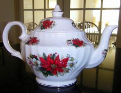 Staffordshire Heritage poinsettia teapot- don't think this is vintage likely modern but sweet and goes with older patterns.