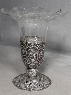 "This sweet early 1900s silver and engraved crystal vase with fluted top rim measures 4 7/8"" x 4 1/8"" overall and is tarnished with no damage to the glass. It is marked as shown; I'm not sure if it is 800 silver or plate."