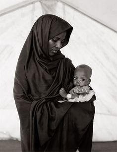 "black-culture: "" "" sincerelymona: "" Abdia Abdi Khalil and her son Hameed, Somali refugee camp, Mandera, Kenya, 1992 "" "" Somali Refugees, Rodney King, Black And White Face, Asian Kids, Madonna And Child, We Are The World, Muslim Women, Mothers Love, Mother And Child"