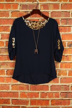 These boutique blouses have to be my favorite blouse this season so far! the little touch of leopard on the back and sleeves are purrrfect!   100%POLYESTER  MADE IN USA