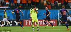 Netherlands rout Spain 5-1;  Holland players celebrate Van Persie's goal