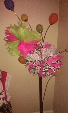 Tissue Paper Pom Poms:  My sister is having a little girl. This will be her second child. We have decided to through her a zebra print baby shower. Our colors we picked are Hot
