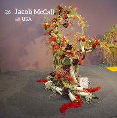 A 100% organic workpiece that is free of floral foam, wire, or metal designed by US contestant Jacob McCall during the Interflora Fleurop World Cup in Berlin Germany Checkout the making off and interview on www.flowerweb.com