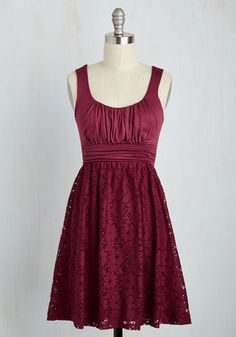 This sleeveless, scoop neck dress reminds us of a cool, sweet, raspberry-infused iced tea. Its ruched top and side panels will invite its floral cutout skirt overlay to dance freely as you step, while its feminine burgundy hue will inspire you to sip tea and chat about faraway places. Garnish with minty fresh flats, tantalizing taupe tights, and a creamy cropped sweater! Love this fetching frock? Check out this dashing design in a host of other haute hues!