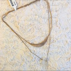 Urban Outfitters Double Chain Necklace a/ Crystal This is a never-worn, brand new double chain necklace from Urban Outfitters. It includes a quartz crystal at the end. Still has original tag! Urban Outfitters Jewelry Necklaces