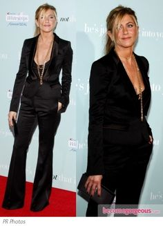 Jen Aniston wearing a black pant suit by Burberry Prorsum for the 'He's Just Not Into You' premiere, Grauman's Chinese Theatre, Hollywood, CA. The plunging neckline is adorned with layered gold necklaces.