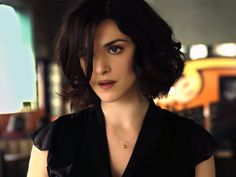 Played in The Brothers Bloom, Agora, The Lovely Bones, in Black Dress and Hair, Impressing One as Simple and Exquisite - HD Rachel Weisz Wallpaper