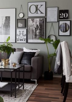 Loving the neutrals and especially love the mixture of photos, prints, mirrors, and numbers on wall.