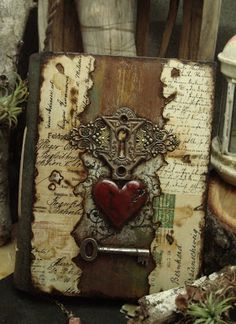 Altered Alchemy Gallery: Handmade Journals Miss Rose Sister Violet a blood red heart, an antique lock and the key to unlock love`s secrets