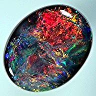 Beautiful black opals- i could look at these all day! Goal: find this stone in earrings, necklace, and bracelet!