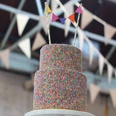 Sprinkles wedding cake with miniature bunting by Emma Page Buttercream Cakes, London