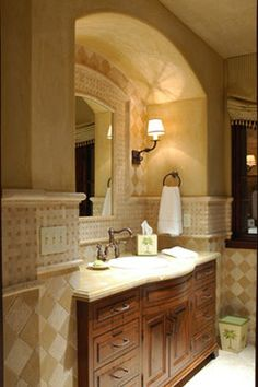 Wood tone and light stone top. Palm Desert Oasis mediterranean bathroom