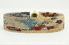 Multicolored blue red cream gold gray by RubyMoonBeadweaver