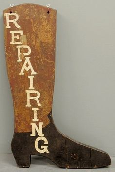 """Carved boot trade sign """"Repairing"""", late 19th c. - Sold For $500"""