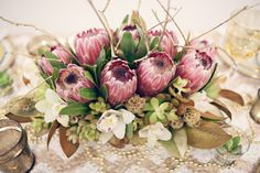 Pink protea, cymbidium orchid blooms, succulents, tweedia + scabisoa pods = beautiful centerpiece - New Year's Eve Photo shoot from Kelsea Holder Photography Protea Centerpiece, Wedding Centerpieces, Wedding Table, Wedding Decorations, Hip Wedding, Wedding Ideas, Wedding Ceremony, Rustic Wedding, Wedding Inspiration