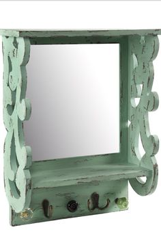 With a distressed mint finish and scrolling design, this lovely wall shelf features a mirror and 3 hooks—perfect for hanging jewelry and scarves. Color Menta, Hanging Jewelry, French Decor, New Wall, Engineered Wood, Wall Shelves, Rustic Farmhouse, Home Furnishings, Diy Home Decor