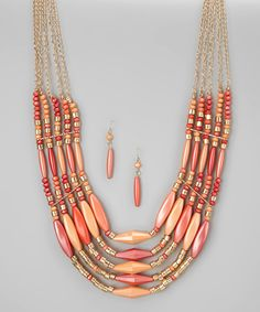 Add enchanted elegance to an ensemble with these dramatic earrings and necklace. The sun-inspired hues and stunning gold chain details make this glittering pair a show-stopping set.Includes necklace and earringsChain: 24'' long with 2.5'' extenderEarrings: 1.5'' longGold /resinImported