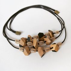 Wood&cut multistrings olive wood necklace, cut and decorated by hand, wax polished.  Brass insert and caucciu strings. Magnet closure. #necklace #collier #jewellery #fattoamano #inspiration #shine #nice #artisan #wood #handmade #cute #black #design #fashion #florence #legno #artigianato #gioielli #gift #winter #special #christmas #unique #bijoux #madeinitaly #collana #etsy #accessories #handmadejewels