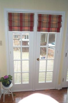 shades for french doors home depot | Roman shades on the french doors.