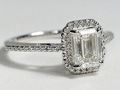 Emerald Cut Halo Diamond 18K White Gold. Min. 1 carat center stone. LOVE it  Mothers Love Free Information on how to (Make Money Online)  http://ibourl.com/1nss
