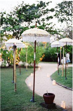 I like the uniqueness of the umbrella decorated path.