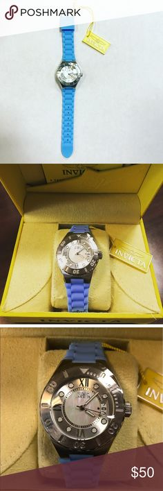 Invicta Angel Quartz Watch Stainless steel and silicone ladies watch. Mother of pearl and stainless steel face. Quartz movement. Light blue silicone strap. Invicta Accessories Watches