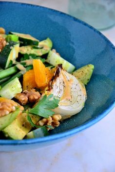 This French Green Bean Salad is loaded with flavor bursting with oranges, cucumbers, roasted onions and more in a beautiful blue bowl.