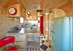 Western themed trailers are popular.  Love the turquoise refrigerator and black and white checked floors.