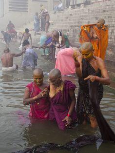 Ritual bathing ~ women from South India take a ritual bath in the Ganges.