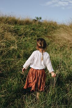 Documentary photography. Lifestyle portrait. Little girl in grass.