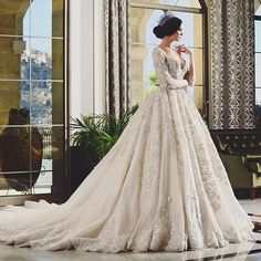 Statement making gown from @ramisalamoun featuring delicate lace details that sparkle! #weddingdress #wedding #bride #gown…