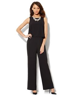 Shop Flounce Overlay Jumpsuit. Find your perfect size online at the best price at New York & Company.