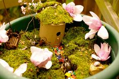 A very simple and inexpensive Fairy House from a cardboard birdhouse found at a craft and hobby store… I cut a door into the birdhouse with a regular kitchen knife, then sprayed it with a waterproofing spray (also from the craft and hobby store). Much could be done to decorate the outside of the fairy …