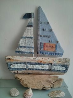 I made this from a lovely piece of driftwood that I found on my local beach. I used old denim jeans and shirt to decorate the sails and base. Sea side art design by Philippa Komercharo.